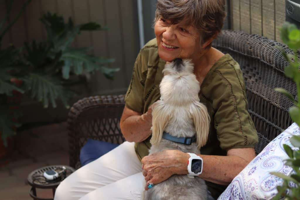 Our editor Taylor Shuman's grandma with her furry friend Reggie