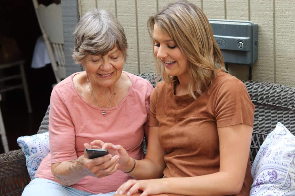 Our editor Taylor Shuman showing her grandma how to use speed up the internet on her iPhone